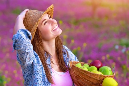 Attractive girl with apples basket
