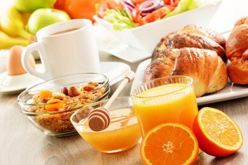 Breakfast including coffee, bread, honey